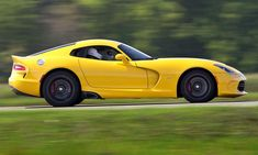 2013 SRT Viper - drive review. The Viper V10 sports car has dropped the Dodge moniker is now an SRT. Click the photo for the full review.