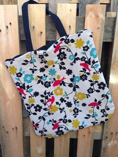black, teal, pink and mustard birds tote bag by Rainy Lain.