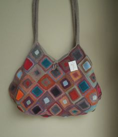 crocheted Quaker Velours bag by Sophie Digard. Lined in beige, bright colors with velvet squares.