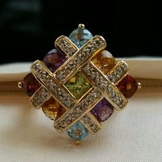 14k multi-gemstone ring -- sz 7 3 carats of genuine, semi precious, cushion cut, garnet, citrine, amythest, blue topaz, and peridot....solid 14k basket weave setting with tiny pronged diamonds that cascade down for a fabulous gallery look! This is a stunner! I love it, but it needs to be worn and sparkle in the light of day ! *jeweler appraised price is $265 (all reasonable offers will be acknowledged ) Jewelry Rings