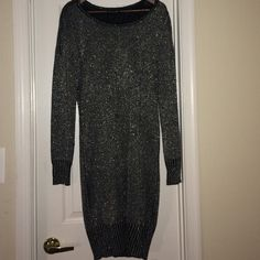 Forever 21 Black and Silver Sweater Dress Dress is from there plus size collection. I am a size 6/8 and curvy at the bottom. The sweater is just sheer so you will need a camisole. The sweater hangs just slightly off the shoulder. Forever 21 Dresses