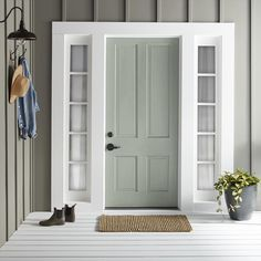 Magnolia's Sir Drake Exterior Paint makes for a welcoming front door. Exterior Gris, Exterior Gray Paint, Front Door Paint Colors, Exterior Paint Colors For House, Painted Front Doors, Paint Colors For Home, Outside House Paint Colors, Magnolia Paint Colors, Gray Exterior Houses