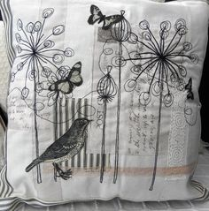 This pretty cushion is made from a cream cotton, collaged with toning fabrics, then machine and hand embroidered. The bird and butterflies are printed and then appliquéd. Edged with a traditional cream and black ticking fabric, the back of this cover i. Free Motion Embroidery, Machine Embroidery Applique, Learning To Embroider, Bird Applique, Butterfly Quilt, Ticking Fabric, Embroidered Cushions, Thread Art, Fabric Art
