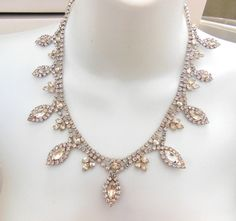 19 length ♦ 1 3/8 center ♦ 1.95 ounces ♦ Rhinestones in silver tone metal ♦ As…