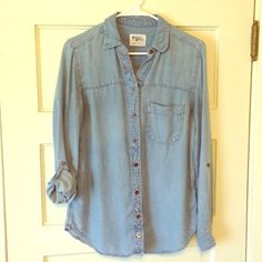 Anthropologie Denim Button Down Shirt Light/faded denim button down shirt by Holding Horses. One top button missing but there is a spare on the tag to be used as replacement (see picture). I love this shirt but it sadly does not fit me anymore-- it is marked Small, but I would say it could fit a Medium as well, it seems to run a big larger than a normal small. Sleeves roll up and button with tab! Nice longer size, light-weight and soft material. Anthropologie Tops Button Down Shirts