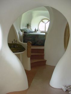 curved walls... i like the idea of curves leading the eye deeper into the house