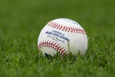 A baseball sits on the field before the game between the Detroit Tigers and the Kansas City Royals at Kauffman Stadium on September 27, 2017 in Kansas City, Missouri. - 1 of 20
