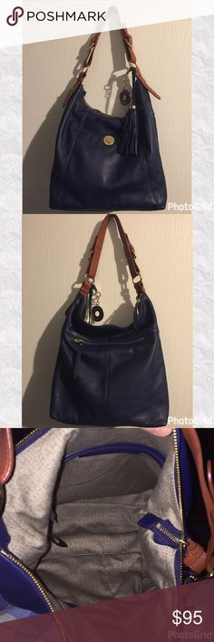 """Isaac Mizrahi Bridgehampton Purse Beautiful pebble leather Bridgehampton purse by Isaac Mizrahi. Carried once. Has two outside pockets. Two inside slip pockets and one zippered pocket. Excellent condition. All hardware works. 13.5 x 15.75 x 4.5"""".  Handle is about 19-20"""" long. Does include dust bag. Isaac Mizrahi Bags"""