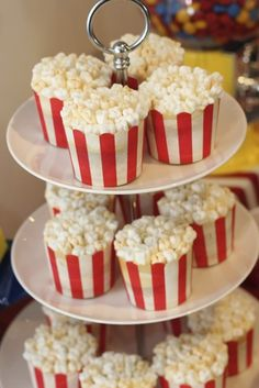 'Popcorn' cupcakes. Cupcakes with small marshmallows arranged on top to resemble popcorn. Cupcake cases from Pink Frosting.
