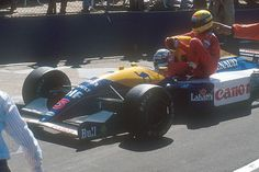 """""""He ain't heavy, he's my brother"""" - Nigel Mansell giving a lift to Ayrton Senna - Silverstone, 1991"""