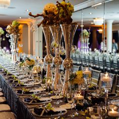 Brides.com: . Shiraz Events crafted an elegant, masculine dinner reception for Jeff and Paul, seating the guests at a long table topped with hues of silver, purple, and pops of green.
