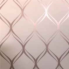 Clifton Wave Geometric Wallpaper Pink / Rose Gold This Clifton Wave Geometric Wallpaper will add a stylish finishing touch to your home and is exclusive to World of Wallpaper. It features an elegant curved geometric design in metallic rose gold, s Pink Wallpaper Bedroom, Pink And Grey Wallpaper, Gold Wallpaper Background, Wall Wallpaper, Wallpaper For Living Room, Ocean Wallpaper, Wallpaper Designs, Disney Wallpaper, Wallpaper Quotes