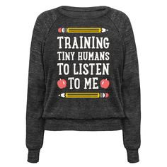 """This teachers design features the text """"Training Tiny Humans To Listen To Me"""" because most early childhood educators know that's half the battle. Perfect for a preschool teacher, teachers, gifts for teachers, teacher humor, and teacher quotes! Preschool Shirts, Teaching Outfits, Teaching Clothes, Teacher Wardrobe, Kindergarten Teachers, Preschool Teacher Quotes, Teacher Style, Teacher Shoes, Teacher Humor"""