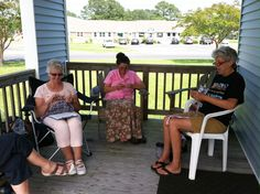 Knitters demonstrate their talent on our Porch.