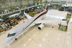 A Mitsubishi Aircraft Corp. Regional Jet sits in a hangar in June in Toyoyama, Aichi Prefecture. Japan Airlines Co. on Thursday announced plans to buy 32 MRJs, in a deal estimated at around ¥150 billion, and to begin using them in 2021 on domestic routes.