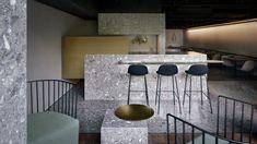 Intersecting volumes of grey terrazzobreak up this Beijing pizza-restaurantinterior, designed by Italian-German architectural practice MDDM Studio.