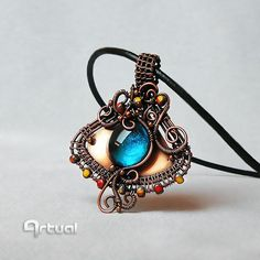 Boho copper pendant with blue glass cabochon and faceted by Artual