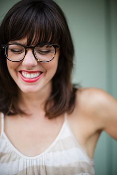 bangs, bold frames, and bright lip.  perfection.