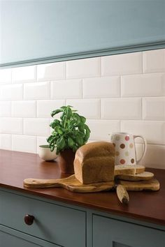metro tiles in the kitchen with a stronger blue colour above so would need more of a duck egg blue or keep the green