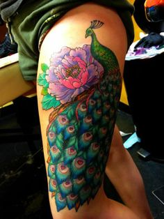 Peacock thigh piece.  This is exactly how/where I want mine, minus the flowers