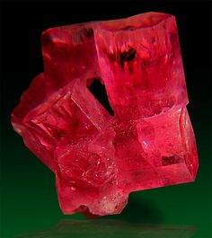 Red beryl crystals range in color from orange-red to purplish-red with medium tones. The largest crystal ever found weighed 54 carats. An average faceted gem stone weighs carats with the largest at carats. The only locality for red beryl crystals Minerals And Gemstones, Rocks And Minerals, Large Crystals, Stones And Crystals, Gem Stones, Rare Gems, Beautiful Rocks, Mineral Stone, Rocks And Gems