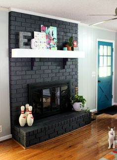 Satin black paint enlivens this brick fireplace!! | First Home ...