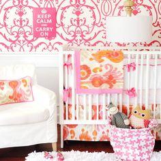 pink + orange patterns in nursery