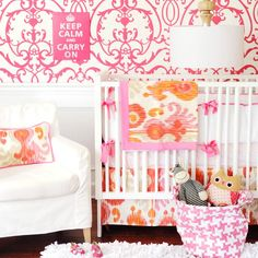 Orange and Hot Pink Nursery by Layla Grace. LOVE the Ikat bedding in pink/orange/white...not crazy about wall print..i'd do small imperfect dots print