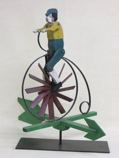 Lot:Folk art high wheel bicycle with rider whirligig in, Lot Number:11, Starting Bid:$200, Auctioneer:Hyde Park Country Auctions, Auction:Folk art high wheel bicycle with rider whirligig in, Date:07:00 AM PT - Jan 4th, 2014