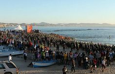 Contestants and spectators await the start of the 2013 Ironman Triathlon in Los Cabos