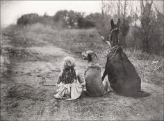 .Trying to figure out what they may be waiting for and how they got the mule or horse to sit . :))