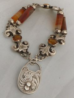Stunning heavy Scottish silver Agate and Citrine bracelet http://www.thesterlingsilver.com/product/fairy-charm/