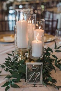 simple wedding centerpiece ideas with candles and greenery #emmalovesweddings #weddingideas2019