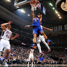 The Knicks' Tyson Chandler goes in for a big finish in the first half against the Nets.