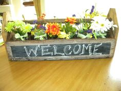 Tool box turned flower box rustic indeed... use it for something other than flowers
