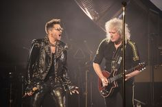 Photo: NEW YORK, NY - JULY 17: Singer Adam Lambert (L) performs with guitarist Brian May of Queen at Madison Square Garden on July 17, 2014 in New York City. (Photo by Michael Loccisano/Getty Images) | Bustle