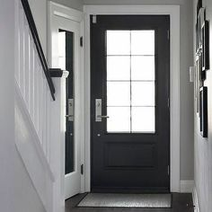 A black front door with 8 glass panes opens to a chic foyer filled with a corner. A black front door with 8 glass panes opens to a chic foyer filled with a corner coat closet accent Grey Walls White Trim, Light Grey Walls, Gray Walls, White Wood, Grey Light, Dark Wood Furniture, Wood Bedroom Furniture, Furniture Ideas, Paint Colors For Home