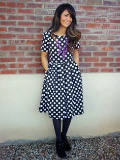 Polka Dot Dress by LulaRoe, love the pockets! Purple bubble necklace, black tights, black ankle boots.