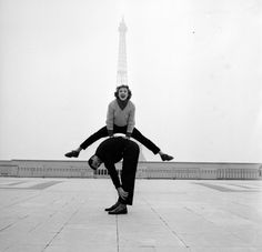 Paris street performers Jean Louis Bert and Grethe Bulow playing leap-frog in front of the Eiffel Tower. © Jean Berton