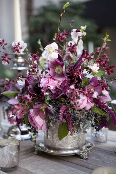 This floral arrangement is amazing and has every color in it that I would want. For the room, more of the neutrals would be used with pops of the plum and green.