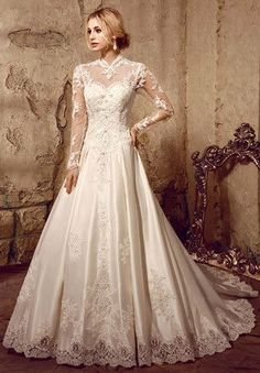 This gorgeous modest lace ball gown wedding dress classic and elegant, with lace illusion neckline back, long lace sleeves, edged with lace appliques. Romantic lace adorns the bodice before meeting a