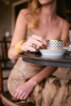 I like that ring, teacup and dress...