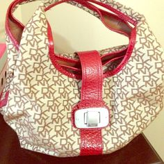 DKNY handbag. DKNY handbag.  Bag in good condition.  The handles doesn't stand straight they bent down to the side. DKNY Bags