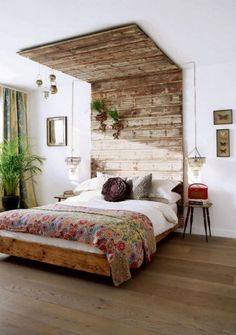 recycled timber slat bedhead that also goes over the ceiling....clever DIY idea home decor