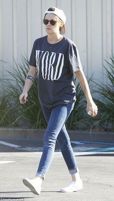 Casual look: Kristen Stewart was wearing a grey T-shirt and skinny jeans as she headed out for a walk in Los Angeles on Wednesday aftermoon
