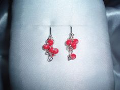 Chaos Wire Wrapped Earrings with coral glass beads.