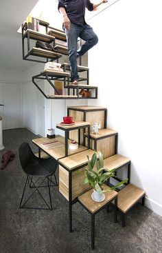 This Staircase Shelf Look Stylish While Also Combining Necessities #stairs trendhunter.com