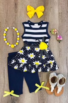 These little capri sets are so cute and the daisy is so trendy! Navy & white capris and a matching short sleeve top with a daisy appliqued on the front. T