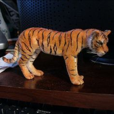 Realistic and Just Plain Fun, Miniature Animals in Several Scales: A dolls house scale tiger of flocked polymer clay by Linda Fisher