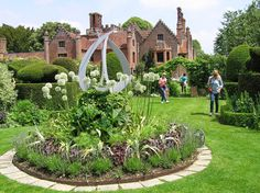 Chenies Manor, Chenies, Buckinghamshire, England, is a Tudor Grade I listed building once known as Chenies Palace. It is owned by the Cheyne family who were granted the manorial rights in 1180. The semi-fortified brick manor house which forms the core of the present day structure was built by Sir John Cheyne in approximately 1460. The original manor house was extended in the 16th century by John Russell, later 1st Earl of Bedford, to whom the property passed through marriage.